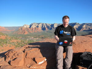 Me hacking at the Red Rocks. Of course this photo is totally faked, it's not even my laptop. ;)